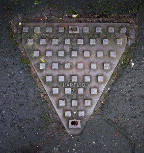 The Iron Triangle - A triangular manhole cover from Belfast, Ireland